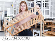 Купить «Girl looking for shoe rack in shop», фото № 34030103, снято 15 января 2018 г. (c) Яков Филимонов / Фотобанк Лори