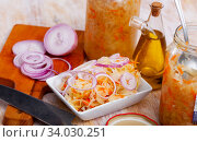 Купить «Sauerkraut with carrots and onion in plate on the table», фото № 34030251, снято 1 июля 2020 г. (c) Яков Филимонов / Фотобанк Лори