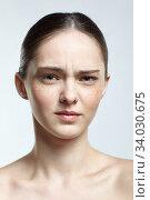 Купить «Headshot of emotional female face portrait with suspicious facial expression.», фото № 34030675, снято 8 мая 2020 г. (c) Serg Zastavkin / Фотобанк Лори