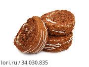 Купить «Slices of sweet roll cake isolated on white background», фото № 34030835, снято 18 января 2016 г. (c) Nataliia Zhekova / Фотобанк Лори