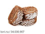 Slices of sweet chocolate roll cake isolated on white. Стоковое фото, фотограф Nataliia Zhekova / Фотобанк Лори