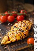 Купить «Grilled chicken fillets on wooden cutting board», фото № 34031031, снято 22 марта 2019 г. (c) Nataliia Zhekova / Фотобанк Лори