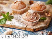 Sweet muffins. Homemade bakery on wooden background. Berry muffins. Стоковое фото, фотограф Nataliia Zhekova / Фотобанк Лори