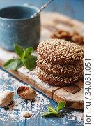 Купить «Chocolate cookies with sesame seeds on the wooden board.», фото № 34031051, снято 22 марта 2019 г. (c) Nataliia Zhekova / Фотобанк Лори