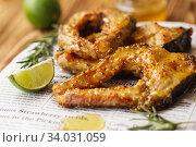 Купить «Carp baked in honey mustard sauce. Fried Slices of Big River Fish.», фото № 34031059, снято 22 марта 2019 г. (c) Nataliia Zhekova / Фотобанк Лори