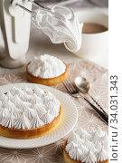 Купить «Beautiful freshly made white lemon meringue tart on plate.», фото № 34031343, снято 9 февраля 2019 г. (c) Nataliia Zhekova / Фотобанк Лори