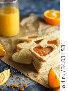 Купить «Shortbread cookies with orange icing in the shape of hearts», фото № 34031531, снято 4 февраля 2019 г. (c) Nataliia Zhekova / Фотобанк Лори