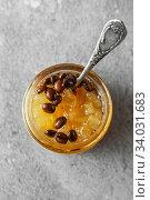 Купить «candied fruit jelly. pear marmalade with coffee beans. Jar of pear jam», фото № 34031683, снято 23 апреля 2019 г. (c) Nataliia Zhekova / Фотобанк Лори