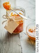 Apricot jam on a wooden rustic background. Стоковое фото, фотограф Nataliia Zhekova / Фотобанк Лори
