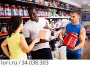 Купить «physically fit people discussing modern sport nutrition», фото № 34038303, снято 13 июля 2020 г. (c) Яков Филимонов / Фотобанк Лори