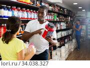 Woman choosing sports supplements in store. Стоковое фото, фотограф Яков Филимонов / Фотобанк Лори