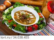 Купить «Stewed chicken hearts with vegetables and greens», фото № 34038455, снято 13 июля 2020 г. (c) Яков Филимонов / Фотобанк Лори