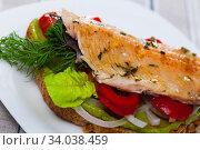 Купить «Appetizing sandwich with roasted trout», фото № 34038459, снято 11 июля 2020 г. (c) Яков Филимонов / Фотобанк Лори
