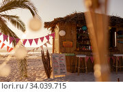 Купить «Japan garlands and a hut on beach», фото № 34039715, снято 25 февраля 2020 г. (c) Wavebreak Media / Фотобанк Лори