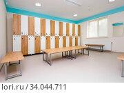 Купить «Interior of gym locker room, brown, blue and white colored», фото № 34044711, снято 6 июля 2020 г. (c) easy Fotostock / Фотобанк Лори