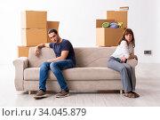 Купить «Young pair and many boxes in divorce settlement concept», фото № 34045879, снято 3 сентября 2019 г. (c) Elnur / Фотобанк Лори