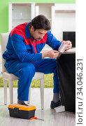 Купить «Repair contractor repairing broken furniture at home», фото № 34046231, снято 15 мая 2018 г. (c) Elnur / Фотобанк Лори