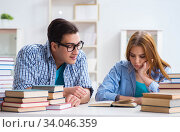 Pair of students studying for university exams. Стоковое фото, фотограф Elnur / Фотобанк Лори