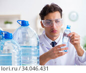Купить «Lab assistant testing water quality», фото № 34046431, снято 1 ноября 2017 г. (c) Elnur / Фотобанк Лори