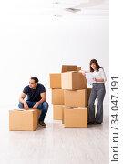 Купить «Young pair and many boxes in divorce settlement concept», фото № 34047191, снято 3 сентября 2019 г. (c) Elnur / Фотобанк Лори