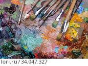 Купить «palette with paintbrush and palette-knife», фото № 34047327, снято 27 марта 2016 г. (c) Nataliia Zhekova / Фотобанк Лори