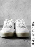Купить «White plimsolls made of tumbled leather, matching laces, fabric lining and lightweight platform soles», фото № 34047359, снято 10 апреля 2019 г. (c) Nataliia Zhekova / Фотобанк Лори