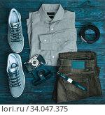 Купить «Hipster clothes and accessories on a wooden background», фото № 34047375, снято 15 января 2017 г. (c) Nataliia Zhekova / Фотобанк Лори