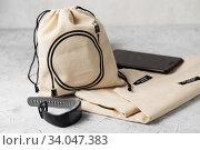 Купить «Canvas bag with drawstring, mockup of small eco sack made from natural cotton fabric», фото № 34047383, снято 14 февраля 2019 г. (c) Nataliia Zhekova / Фотобанк Лори