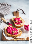 Bruschetta with Beetroot hummus decorated with chopped nuts and microgreen. Vegan recipes, plant-based dishes. Green living concept. Organic food. Vegetarian cuisine. Bread with pink dip. Стоковое фото, фотограф Nataliia Zhekova / Фотобанк Лори