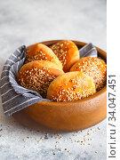 Купить «bun buns with sesame seeds on a wooden board.», фото № 34047451, снято 10 апреля 2020 г. (c) Nataliia Zhekova / Фотобанк Лори