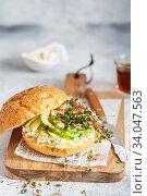 Купить «Healthy sandwich with bread, fresh avocado and cheese garnished with radish microgreens. Healthy eating concept. Avocado, ricotta cheese and radish sprouts», фото № 34047563, снято 22 января 2020 г. (c) Nataliia Zhekova / Фотобанк Лори