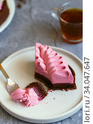 Купить «A slice of cake in the process of eating with a dessert fork.», фото № 34047647, снято 24 января 2020 г. (c) Nataliia Zhekova / Фотобанк Лори
