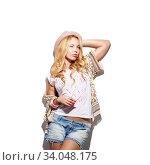Купить «Fashion model girl portrait dressed in top, cardigan, denim shorts, hat and modern accessories», фото № 34048175, снято 13 марта 2016 г. (c) Nataliia Zhekova / Фотобанк Лори