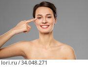 Купить «beautiful young woman pointing to her eye», фото № 34048271, снято 30 ноября 2019 г. (c) Syda Productions / Фотобанк Лори