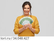 Купить «happy smiling young woman with euro money», фото № 34048427, снято 20 марта 2020 г. (c) Syda Productions / Фотобанк Лори