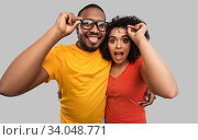 Купить «happy african american couple in glasses hugging», фото № 34048771, снято 15 декабря 2019 г. (c) Syda Productions / Фотобанк Лори
