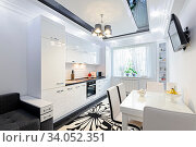 Luxury modern black and white kitchen with carpet on floor. Стоковое фото, фотограф Zoonar.com/Serghei Starus / easy Fotostock / Фотобанк Лори