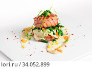 Veal medallions with spinach on white background. Стоковое фото, фотограф Zoonar.com/Serghei Starus / easy Fotostock / Фотобанк Лори
