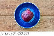 Purple head of red cabbage on a blue plate on a wooden tabletop. Стоковое фото, фотограф Евгений Харитонов / Фотобанк Лори