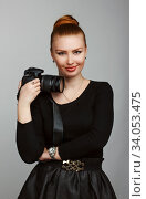 Portrait of a young beautiful girl photographer with his camera. Стоковое фото, фотограф Nataliia Zhekova / Фотобанк Лори