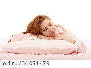 Купить «Young beautiful girl sleeps in the bed hugging a pillow on his stomach. Healthy sleep.», фото № 34053479, снято 18 мая 2015 г. (c) Nataliia Zhekova / Фотобанк Лори