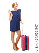 Купить «Full length portrait of a young woman standing with a pink travel suitcase and waving goodbye», фото № 34053547, снято 2 апреля 2015 г. (c) Nataliia Zhekova / Фотобанк Лори