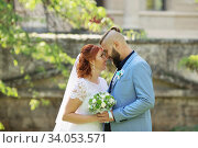 Купить «Just married loving hipster couple in wedding dress and suit in the park. Happy bride and groom walking running and dancing. Romantic Married young family.», фото № 34053571, снято 5 октября 2018 г. (c) Nataliia Zhekova / Фотобанк Лори