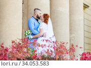 Купить «Just married loving hipster couple in wedding dress and suit in the park. Happy bride and groom walking running and dancing. Romantic Married young family.», фото № 34053583, снято 5 октября 2018 г. (c) Nataliia Zhekova / Фотобанк Лори