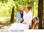 Купить «Just married loving hipster couple in wedding dress and suit in the park. Happy bride and groom walking running and dancing. Romantic Married young family.», фото № 34053599, снято 5 октября 2018 г. (c) Nataliia Zhekova / Фотобанк Лори
