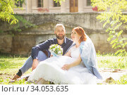 Купить «Just married loving hipster couple in wedding dress and suit in the park. Happy bride and groom walking running and dancing. Romantic Married young family.», фото № 34053635, снято 5 октября 2018 г. (c) Nataliia Zhekova / Фотобанк Лори