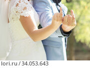 couple showing middle fingers with wedding rings. Стоковое фото, фотограф Nataliia Zhekova / Фотобанк Лори