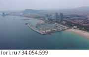 Купить «Scenic view from drone of seaside area of Barcelona on sunny summer day, Catalonia», видеоролик № 34054599, снято 7 июля 2019 г. (c) Яков Филимонов / Фотобанк Лори