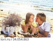 Купить «happy young couple enjoying picnic on the beach and have good time on summer», фото № 34054863, снято 6 сентября 2014 г. (c) Nataliia Zhekova / Фотобанк Лори