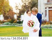 Купить «Beautiful young bride and groom in love», фото № 34054891, снято 1 ноября 2014 г. (c) Nataliia Zhekova / Фотобанк Лори